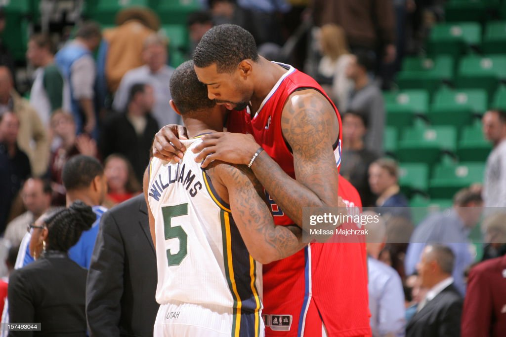 Mo Williams #5 of the Utah Jazz and <a gi-track='captionPersonalityLinkClicked' href=/galleries/search?phrase=DeAndre+Jordan&family=editorial&specificpeople=4665718 ng-click='$event.stopPropagation()'>DeAndre Jordan</a> #6 of the Los Angeles Clippers on court after the Clipper win at Energy Solutions Arena on December 03, 2012 in Salt Lake City, Utah.