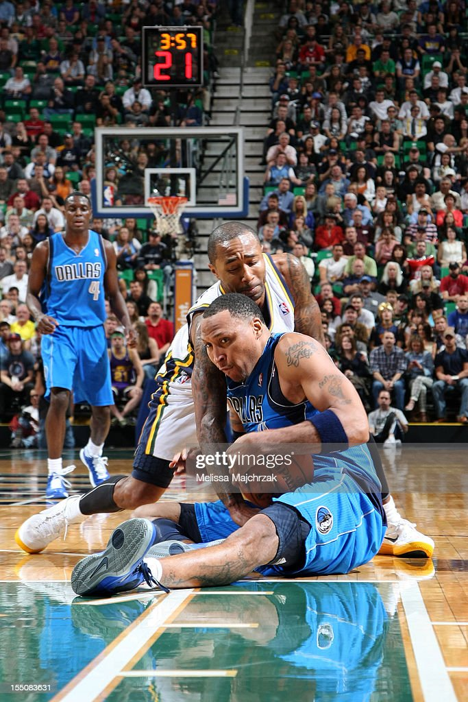 Mo Williams #5 of the Utah Jazz and <a gi-track='captionPersonalityLinkClicked' href=/galleries/search?phrase=Shawn+Marion&family=editorial&specificpeople=201566 ng-click='$event.stopPropagation()'>Shawn Marion</a> #0 of the Dallas Mavericks fight for the ball at Energy Solutions Arena on October 31, 2012 in Salt Lake City, Utah.
