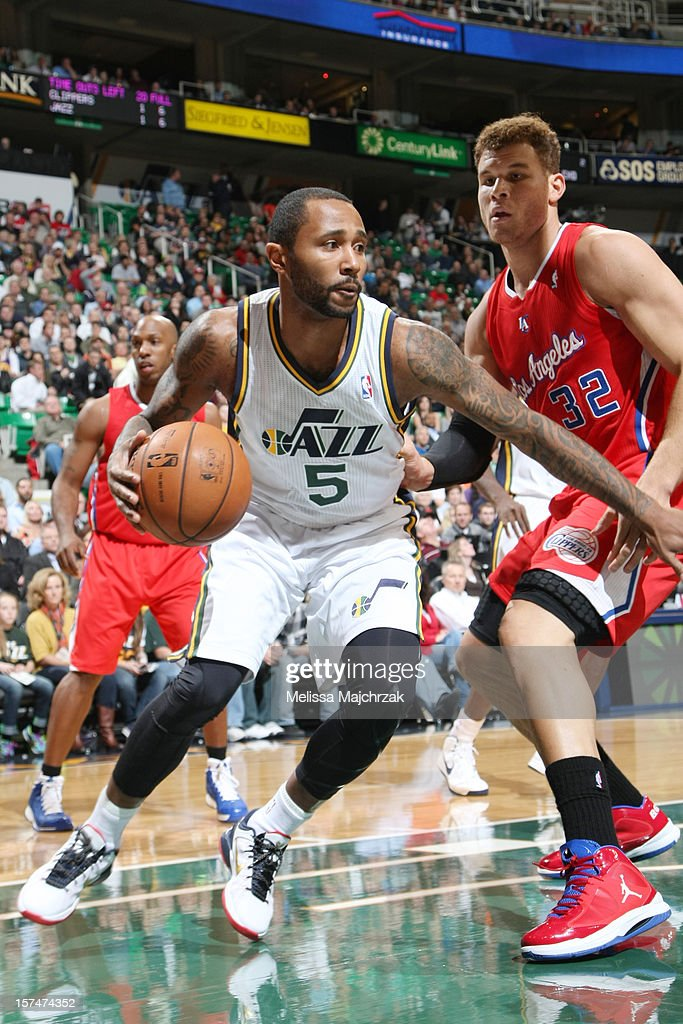 Mo Williams #5 of the Utah Jazz drives against Blake Griffin #32 of the Los Angeles Clippers at Energy Solutions Arena on December 03, 2012 in Salt Lake City, Utah.
