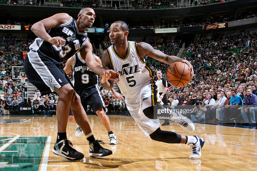 ... Mo Williams 5 of the Utah Jazz drives against Boris Diaw 33 of the ... ad21d3860