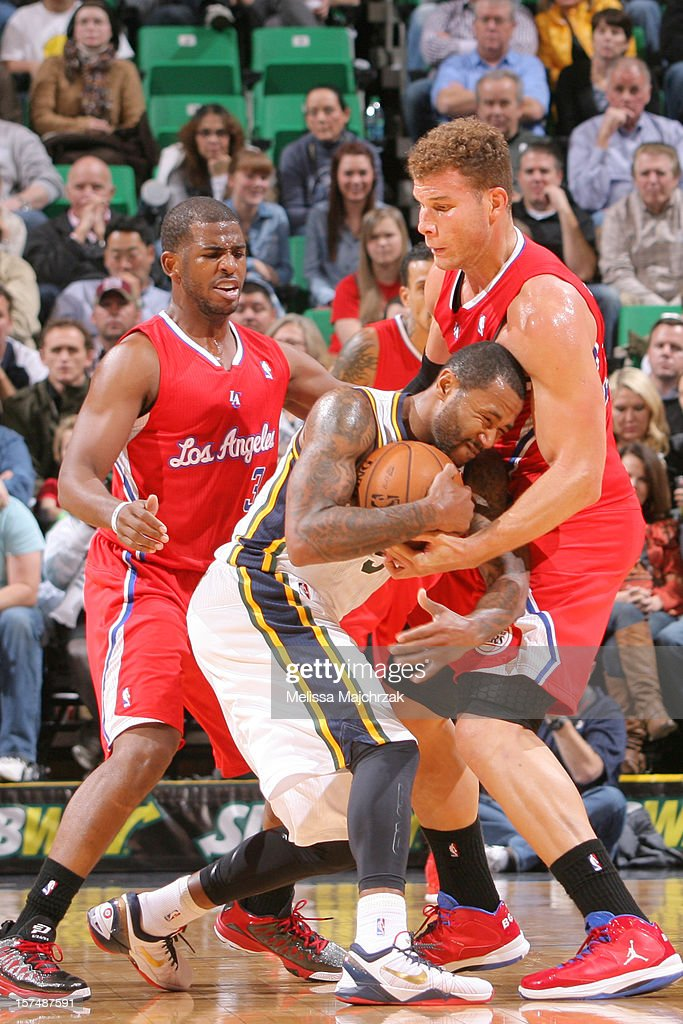 Mo Williams #5 of the Utah Jazz drives against <a gi-track='captionPersonalityLinkClicked' href=/galleries/search?phrase=Chris+Paul&family=editorial&specificpeople=212762 ng-click='$event.stopPropagation()'>Chris Paul</a> #3 and <a gi-track='captionPersonalityLinkClicked' href=/galleries/search?phrase=Blake+Griffin+-+Basketball+Player&family=editorial&specificpeople=4216010 ng-click='$event.stopPropagation()'>Blake Griffin</a> #32 of the Los Angeles Clippers at Energy Solutions Arena on December 03, 2012 in Salt Lake City, Utah.