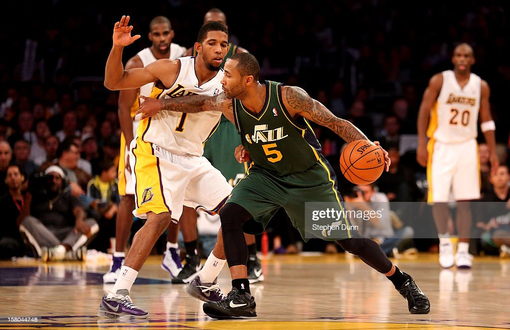 Mo Williams #5 of the Utah Jazz drives against Darius Morris #1 of the Los Angeles Lakers at Staples Center on December 9, 2012 in Los Angeles, California. The Jazz won 117-110.