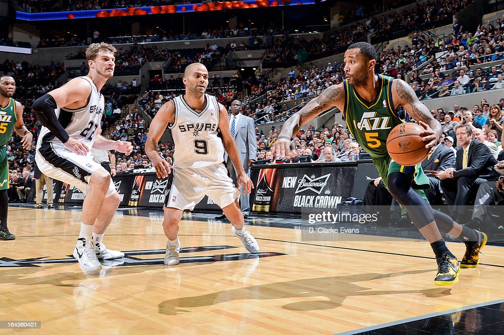 Mo Williams #5 of the Utah Jazz drives against Tony Parker #9 and Tiago Splitter #22 of the San Antonio Spurs on March 22, 2013 at the AT&T Center in San Antonio, Texas.