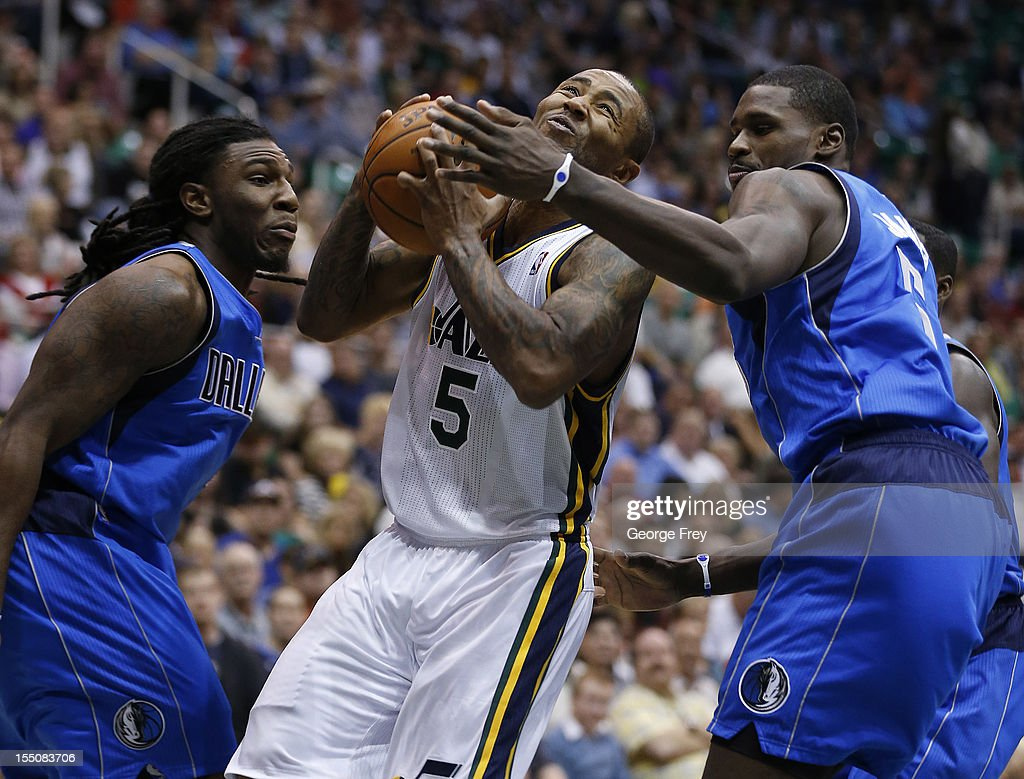 Mo Williams #5 of the Utah Jazz drives between <a gi-track='captionPersonalityLinkClicked' href=/galleries/search?phrase=Bernard+James&family=editorial&specificpeople=7387529 ng-click='$event.stopPropagation()'>Bernard James</a> #5 and <a gi-track='captionPersonalityLinkClicked' href=/galleries/search?phrase=Jae+Crowder&family=editorial&specificpeople=7357507 ng-click='$event.stopPropagation()'>Jae Crowder</a> #9 of the Dallas Mavericks during the second half of an NBA game October 31, 2012 at EnergySolution Arena in Salt Lake City, Utah.