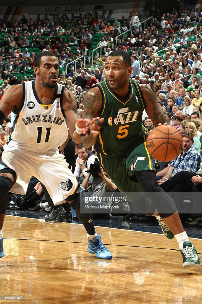 Mo Williams #5 of the Utah Jazz drives to the basket against Mike Conley #11 of the Memphis Grizzlies at Energy Solutions Arena on March 16, 2013 in Salt Lake City, Utah.