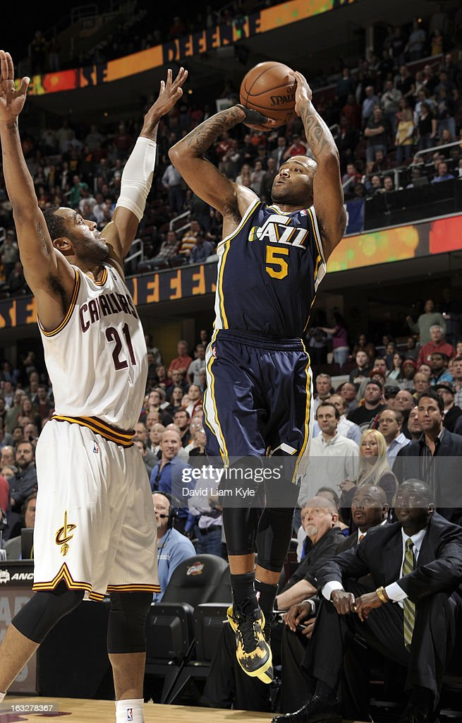 Mo Williams #5 of the Utah Jazz goes up for the shot against Wayne Ellington #21 of the Cleveland Cavaliers at The Quicken Loans Arena on March 6, 2013 in Cleveland, Ohio.