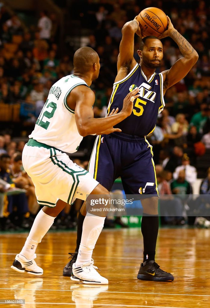 Mo Williams #5 of the Utah Jazz holds the ball in front of Leandro Barbosa #12 of the Boston Celtics during the game on November 14, 2012 at TD Garden in Boston, Massachusetts.