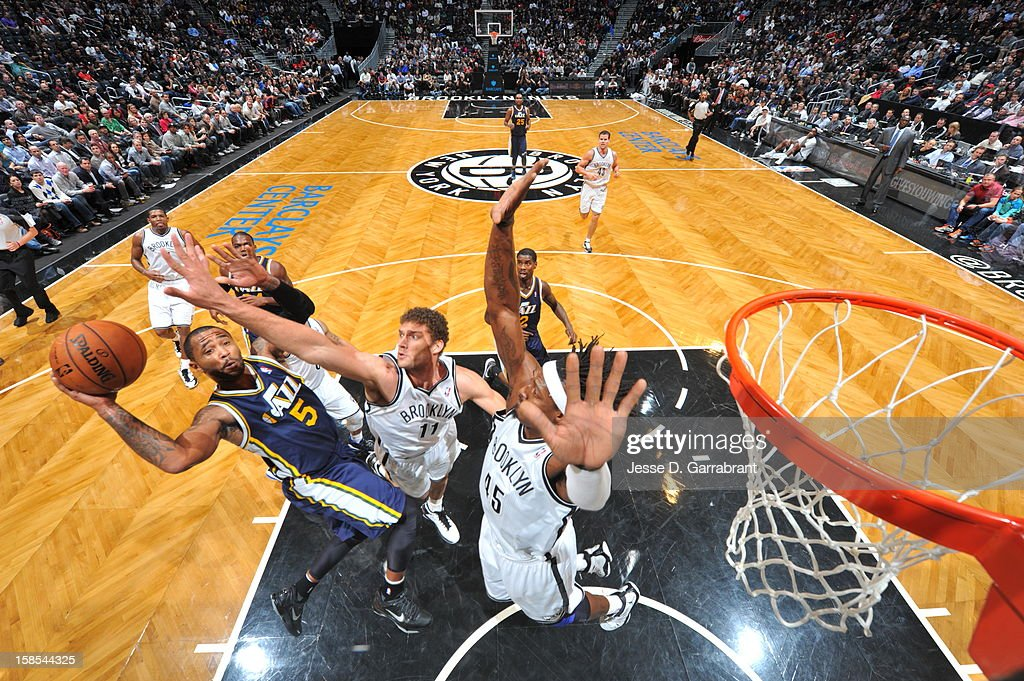 Mo Williams #5 of the Utah Jazz shoots against <a gi-track='captionPersonalityLinkClicked' href=/galleries/search?phrase=Brook+Lopez&family=editorial&specificpeople=3847328 ng-click='$event.stopPropagation()'>Brook Lopez</a> #11 and <a gi-track='captionPersonalityLinkClicked' href=/galleries/search?phrase=Gerald+Wallace&family=editorial&specificpeople=202117 ng-click='$event.stopPropagation()'>Gerald Wallace</a> #45 of the Brooklyn Nets during the game at the Barclays Center on December 18, 2012 in Brooklyn, New York.