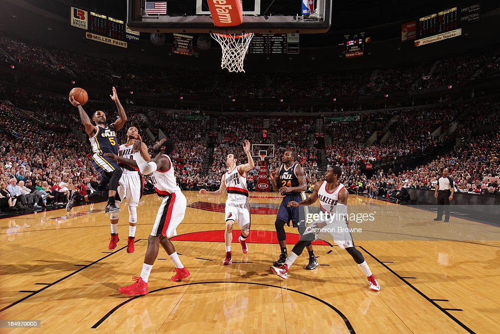Mo Williams #5 of the Utah Jazz shoots against <a gi-track='captionPersonalityLinkClicked' href=/galleries/search?phrase=Damian+Lillard&family=editorial&specificpeople=6598327 ng-click='$event.stopPropagation()'>Damian Lillard</a> #0 and <a gi-track='captionPersonalityLinkClicked' href=/galleries/search?phrase=J.J.+Hickson&family=editorial&specificpeople=4226173 ng-click='$event.stopPropagation()'>J.J. Hickson</a> #21 of the Portland Trail Blazers on March 29, 2013 at the Rose Garden Arena in Portland, Oregon.
