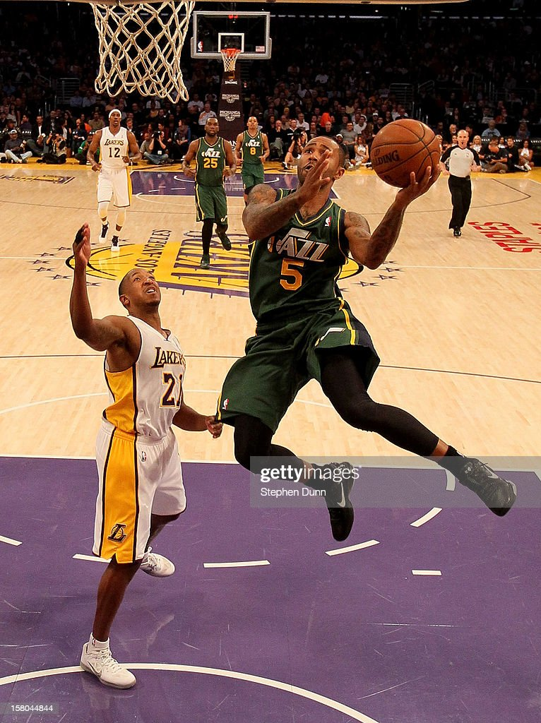 Mo Williams #5 of the Utah Jazz shoots over Chris Duhon #21 of the Los Angeles Lakers at Staples Center on December 9, 2012 in Los Angeles, California. The Jazz won 117-110.