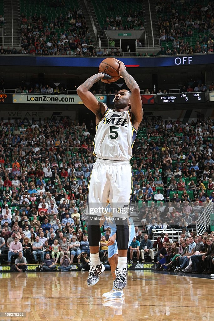 Mo Williams #5 of the Utah Jazz shoots the ball against the Denver Nuggets at Energy Solutions Arena on April 3, 2013 in Salt Lake City, Utah.
