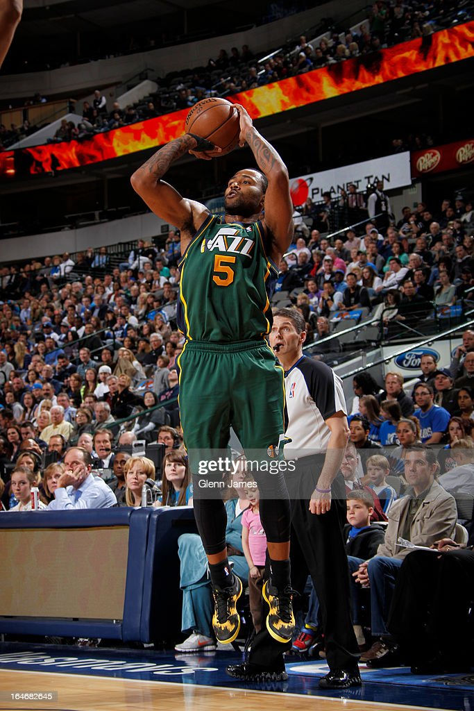 Mo Williams #5 of the Utah Jazz takes a shot against the Dallas Mavericks on March 24, 2013 at the American Airlines Center in Dallas, Texas.
