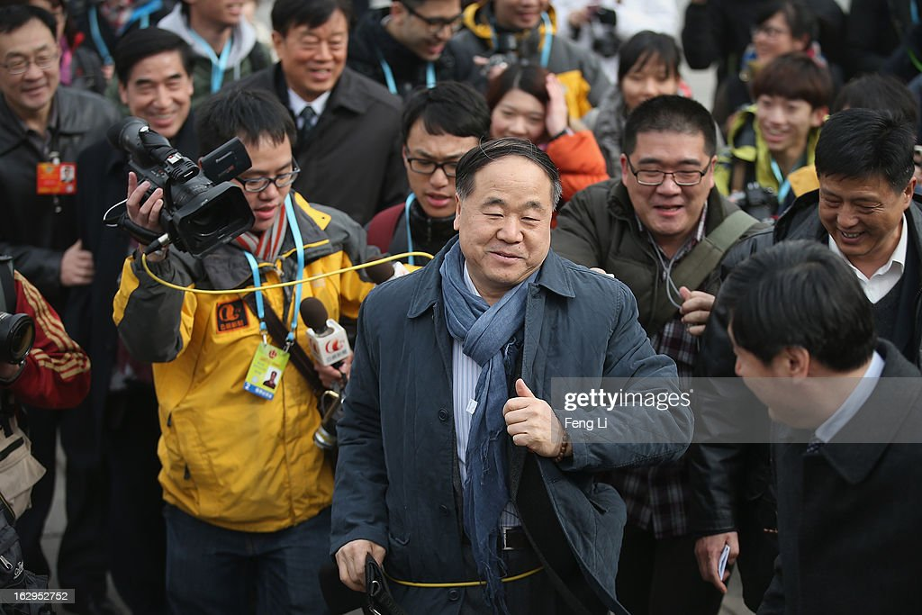 <a gi-track='captionPersonalityLinkClicked' href=/galleries/search?phrase=Mo+Yan&family=editorial&specificpeople=3971964 ng-click='$event.stopPropagation()'>Mo Yan</a>, the first Chinese national to win the Nobel Literature Prize and a delegate to the Chinese People's Political Consultative Conference (CPPCC), walks through a swarm of journalists outside the Great Hall of the People before a pre-opening session of the CPPCC on March 1, 2013 in Beijing, China. The reshuffle will be completed at the first annual session of the 12th National People's Congress (NPC), which is scheduled to begin on March 5, and the first annual session of the 12th National Committee of the Chinese People's Political Consultative Conference (CPPCC), which will commence on March 3.