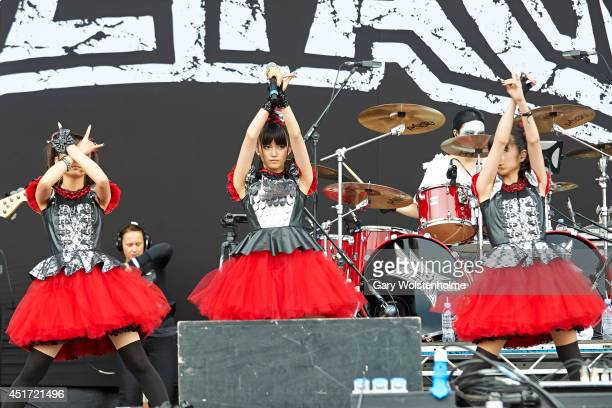 Moa Kikuchi Suzuka Nakamoto and Yui Mizuno of BABYMETAL performs on stage at Sonisphere at Knebworth Park on July 5 2014 in Knebworth United Kingdom