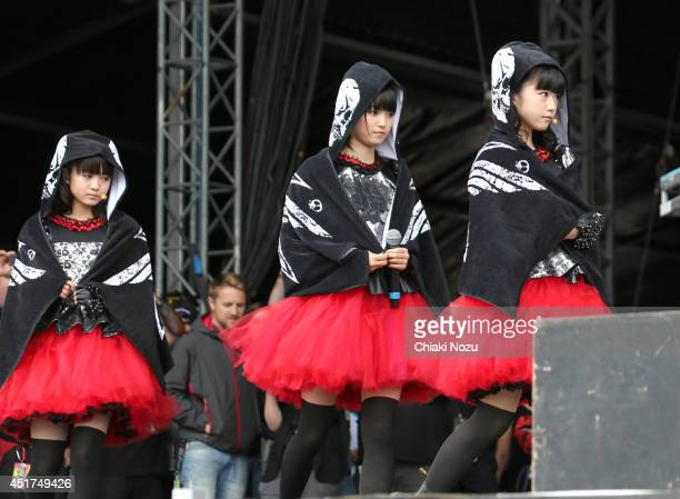 Moametal Sumetal and Yuimetal of Babymetal perform at Day 2 of the Sonisphere Festival at Knebworth Park on July 5 2014 in Knebworth England