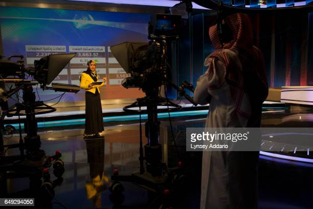 Moamina Faour a 29yearold Palestinian financial reporter who was born and raised in Saudi Arabia shoots a live segment at the studio at the Ministry...