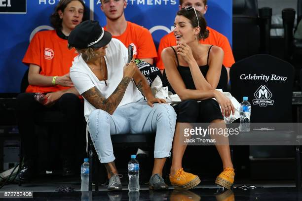 Moana Hope and girlfriend Isabella Carlstorm sit courtside during the round six NBL match between Melbourne United and the Sydney Kings at Hisense...