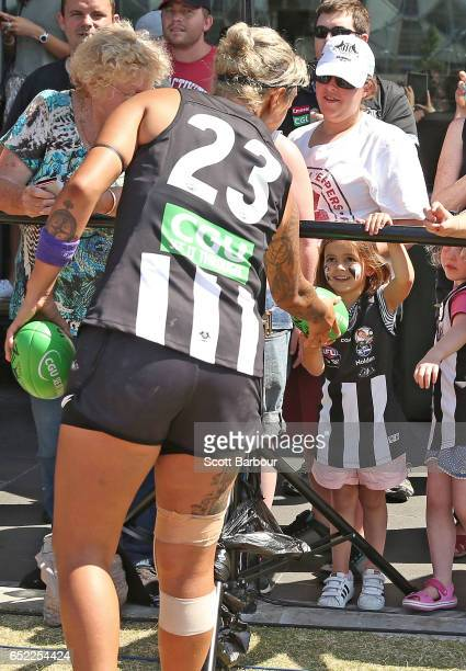 Moana Hope of the Magpies gives a football to a young girl in the crowd after winning the round six AFL Women's match between the Collingwood Magpies...