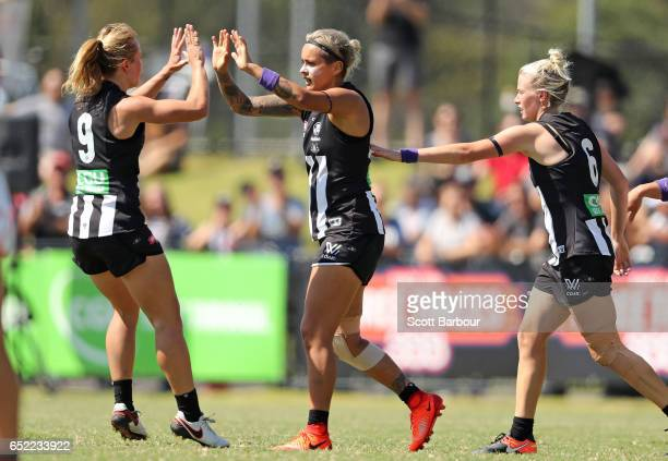 Moana Hope of the Magpies is congratulated by her teammates after kicking a goal during the round six AFL Women's match between the Collingwood...