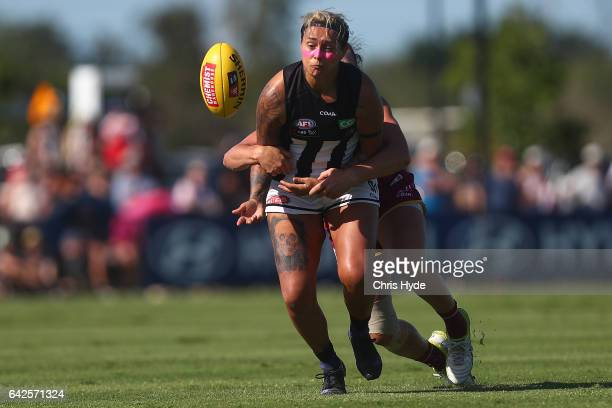 Moana Hope of the Magpies is tackled during the Women's AFL round three match between the Brisbane Lions and the Collingwood Magpies at South Pine...