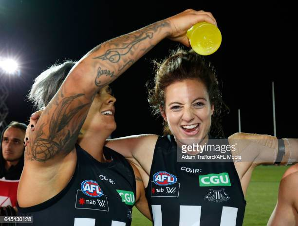 Moana Hope of the Magpies pours gatorade on Stephanie Chiocci of the Magpies during the 2017 AFLW Round 04 match between the Western Bulldogs and...