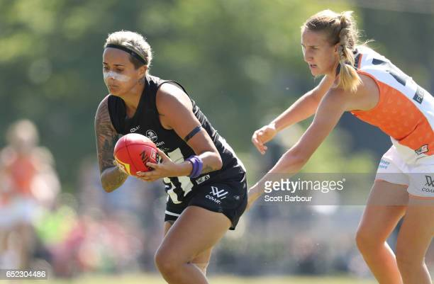 Moana Hope of the Magpies runs with the ball during the round six AFL Women's match between the Collingwood Magpies and the Greater Western Sydney...