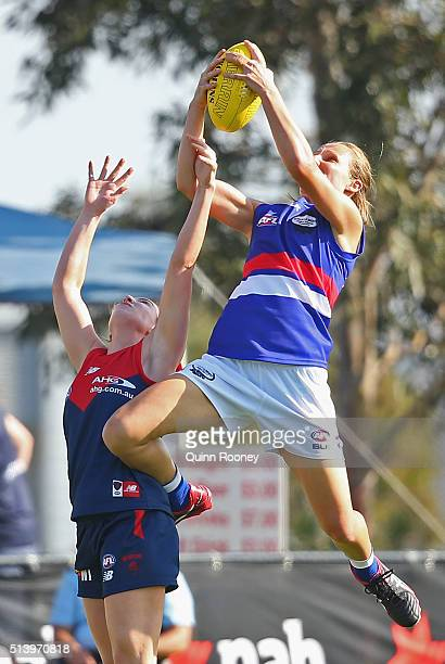 Moanna Hope of the Bulldogs marks over the top of Amelia Barden of the Demons during the Women's AFL Exhibition Match between the Western Bulldogs...