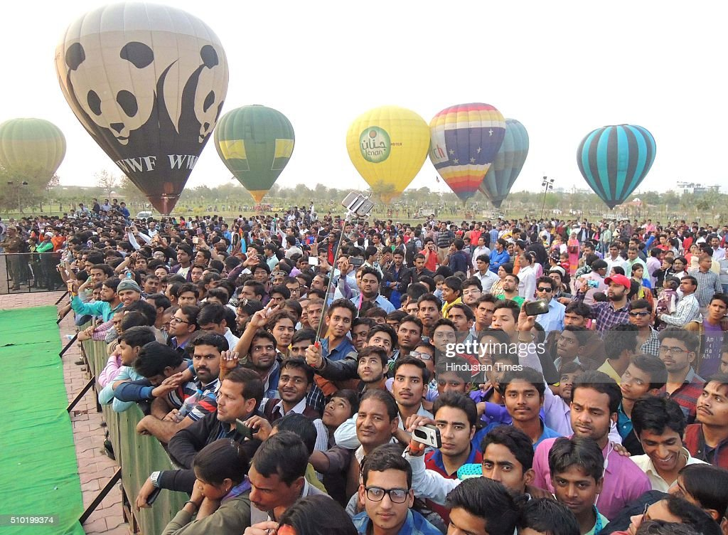 Mob gathered during a Hot Air Balloon festival as a part of 'State Tourism Day' on Tourism day here at Janeshwar Mishra Park on February 14, 2016 in Lucknow, India. Uttar Pradesh Tourism Department has decided to celebrate its own 'State Tourism Day' annually on the Valentine's Day, February 14. The first 'State Tourism Day' will be celebrated in Lucknow but the venue will change to other cities in coming years, Navneet Sehgal, Principal Secretary Tourism added.
