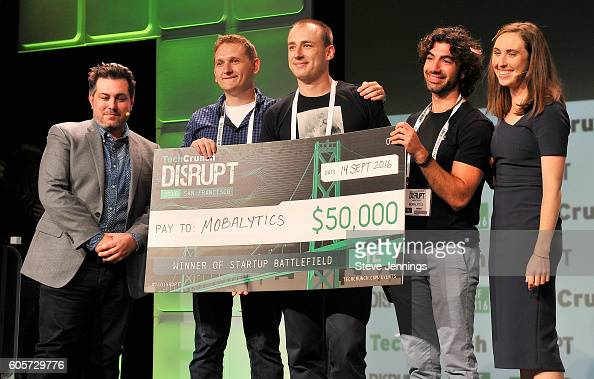 Mobalytics accepts the Disrupt grand prize onstage during TechCrunch Disrupt SF 2016 at Pier 48 on September 14 2016 in San Francisco California