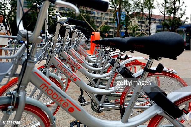 Mobike Lite bicycles park at Baoshan District on October 19 2016 in Shanghai China The bikesharing service company Mobike released a kind of lighter...