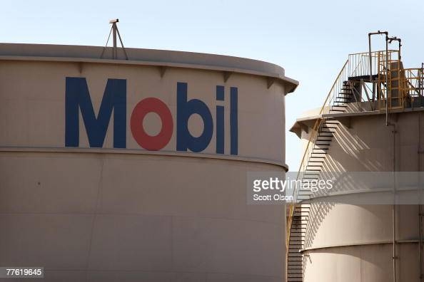 Mobil logo is painted on a storage tank at the Exxon Mobil refinery November 1 2007 in Joliet Illinois The oil company reported a biggerthanexpected...