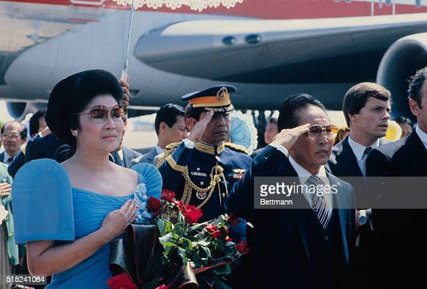 Philippine President Ferdinand E Marcos and his wife Imelda Romualdez Marcos are shown during ceremonies on their arrival here 9/24 Shown at right of...