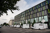 Mobile broadcasting units are parked near the OEZ shopping center the day after a shooting spree left nine victims dead on July 23 2016 in Munich...