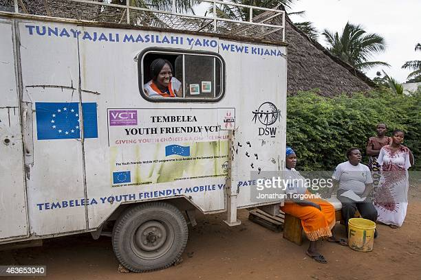A mobile clinic providing women in rural areas family planning options like contraceptive implants and cervical cancer screening at a rural village...