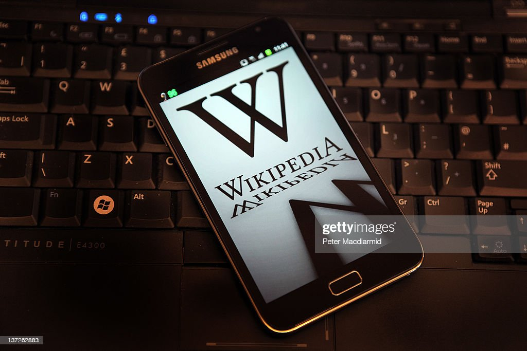 A mobile device shows Wikipedia's front page displaying a darkened logo on January 18, 2012 in London, England. The Wikipedia website has shut down it's English language service for 24 hours in protest over the US anti-piracy laws.