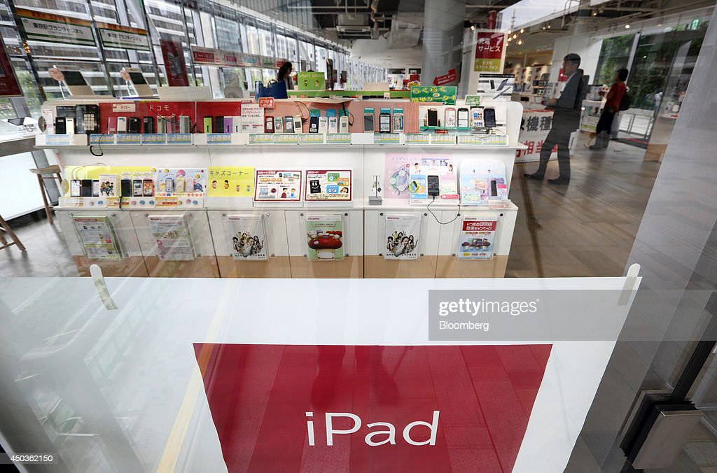 Mobile devices are displayed at an NTT Docomo Inc. store in Tokyo, Japan, on Tuesday, June 10, 2014. NTT Docomo, Japan's largest wireless carrier by subscribers, began offering Apple Inc's iPad today. Photographer: Tomohiro Ohsumi/Bloomberg via Getty Images