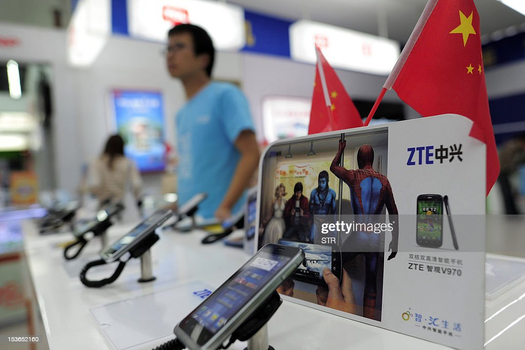 Mobile devices are displayed on a ZTE sales counter in Wuhan, central China's Hubei province on October 8, 2012. Beijing urged Washington to 'set aside prejudices' after a draft Congressional report said Chinese telecom firms Huawei and ZTE were security threats that should be banned from business in the US. CHINA OUT AFP PHOTO