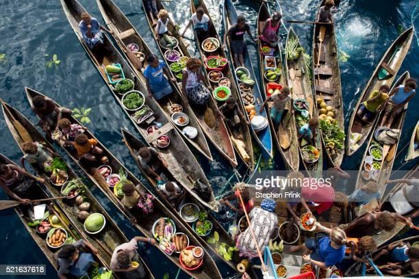Mobile, floating, produce market.
