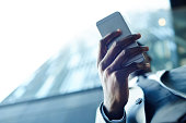Hand of African-american man holding smartphone