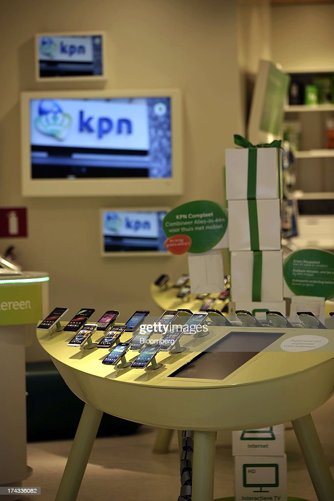 Mobile handsets sit on display inside a Royal KPN NV telecommunications store in Amsterdam, Netherlands, on Tuesday, July 23, 2013. Dutch pension funds will be allowed to calculate liabilities on the basis of an adjusted discount rate as the government seeks to keep the retirement system viable amid low interest rates and an aging population. Photographer: Matthew Lloyd/Bloomberg via Getty Images