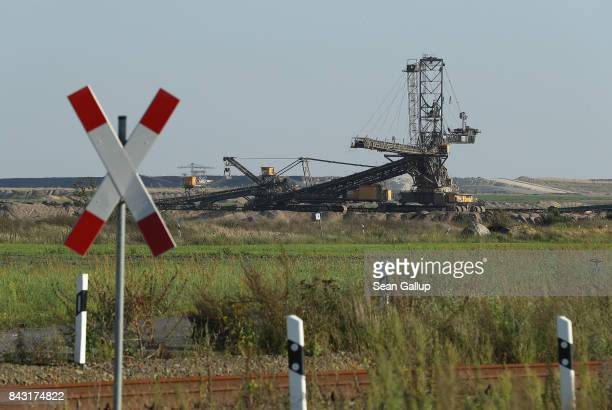 A mobile machine called a spreader stands at the Jaenschwalde openpit lignite coal mine on September 5 2017 near Peitz Germany Germany is making...