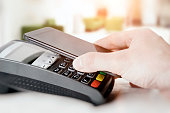 Mobile payment with smart phone. payment nfc near field communication phone credit card concept