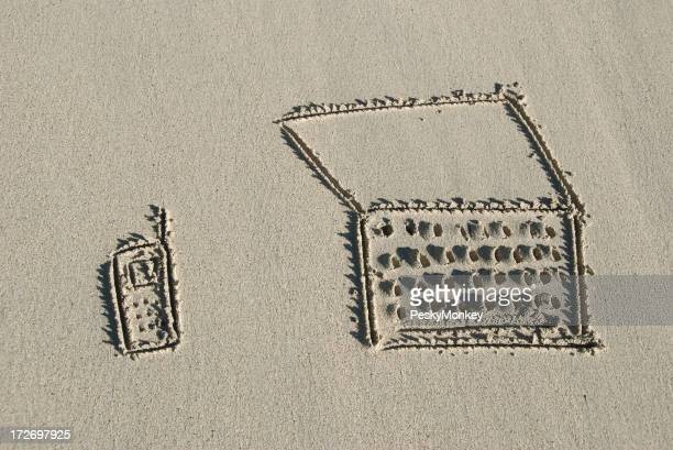 Mobile Phone and Laptop Drawn in Sand