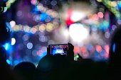 Mobile phone camera take pictures in Concert with