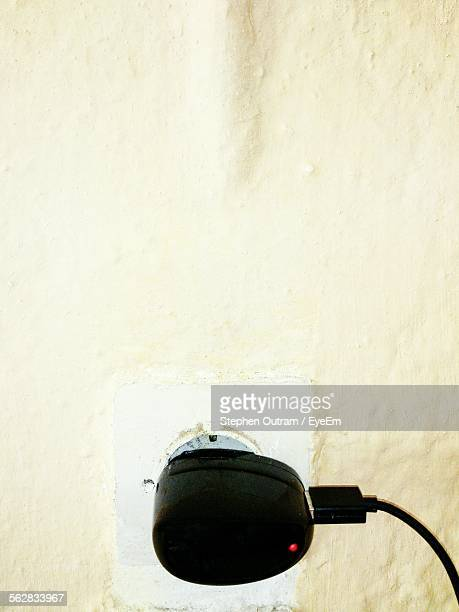Mobile Phone Charger In Wall Socket At Home