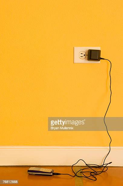 Mobile phone charging in electrical outlet