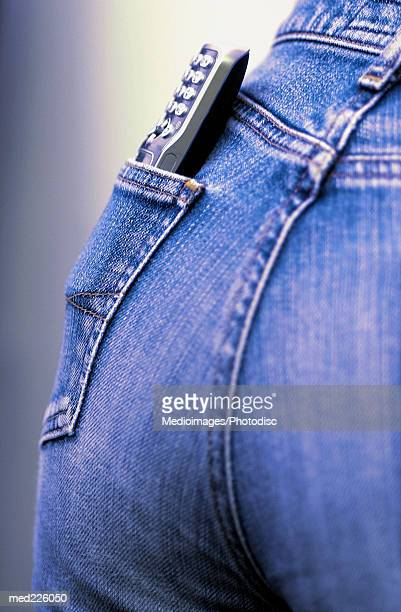 Mobile phone in a person's back pocket