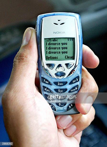 A mobile phone is displayed with the words 'I divorce you' in Kuala Lumpur 31 July 2003 Malaysia plans to outlaw divorce via mobile phone text...