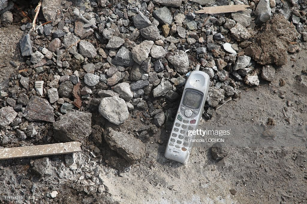 A mobile phone is left in the rubble destroyed by the earthquake on April 4,2011, in Yamda,Japan. These objects are from the 30 000 victims of the earthquake that hit Japan on March 11, 2011 followed by an tsunami.