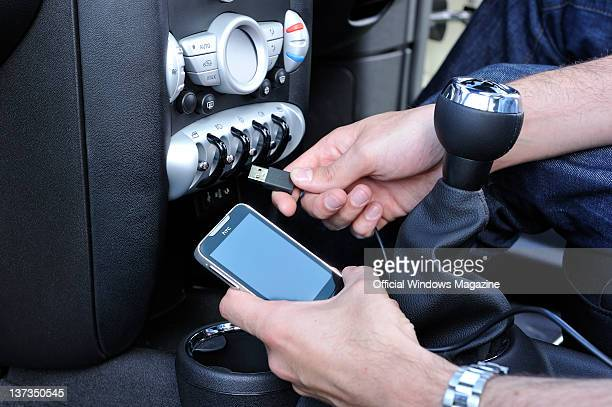 A mobile phone is plugged in to a car with a USB cable August 24 2010